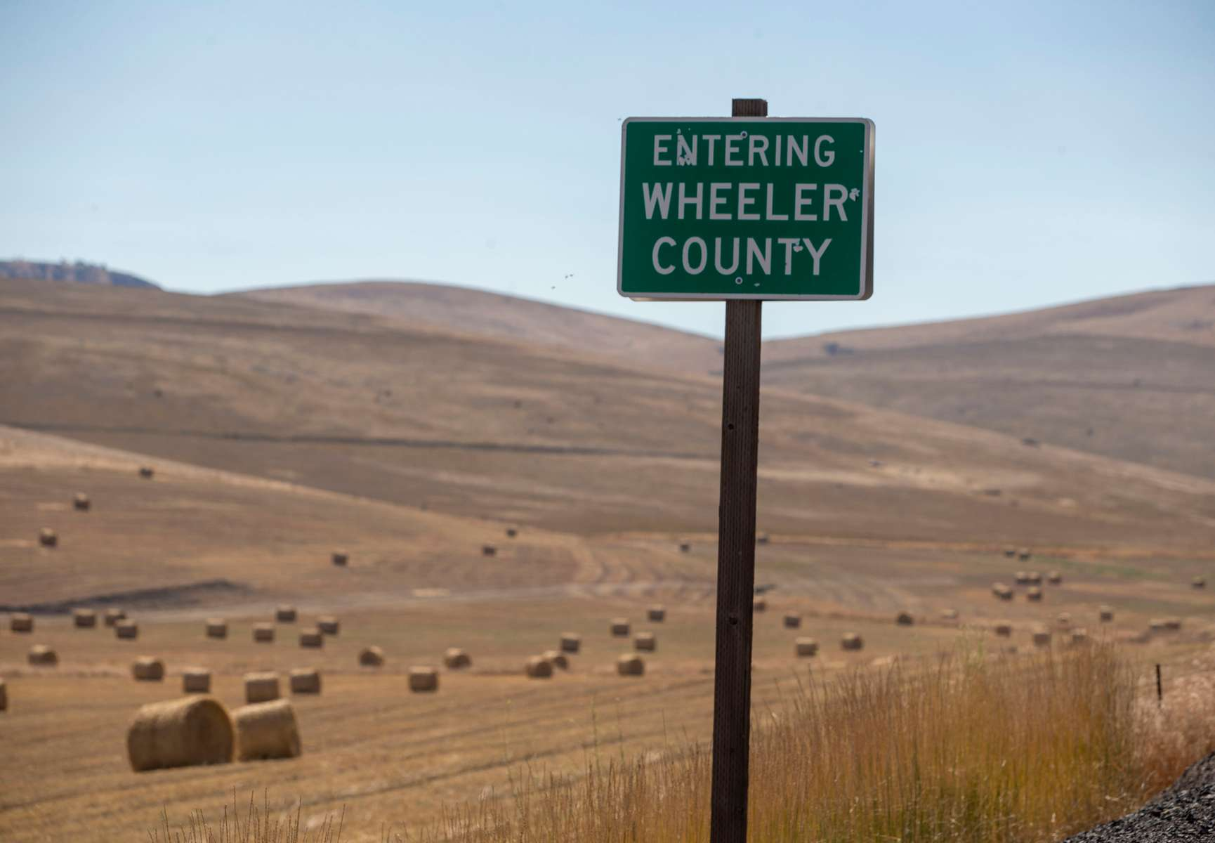 Wheeler County has the distinction of being one of ten counties in the United States without a case of coronavirus. The Wheeler County sign on Highway 19 greets visitors on May 3, 2020, near Fossil, Oregon.