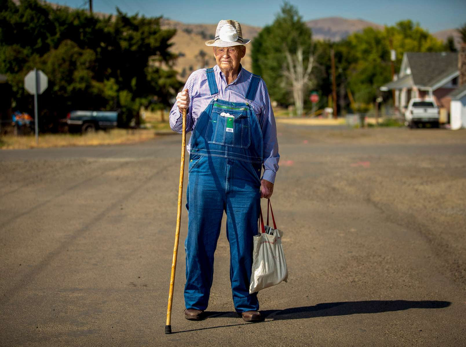 Marvin Mabe pause while returning from the Fossil Mercantile on May 3, 2020, in Fossil, Oregon.