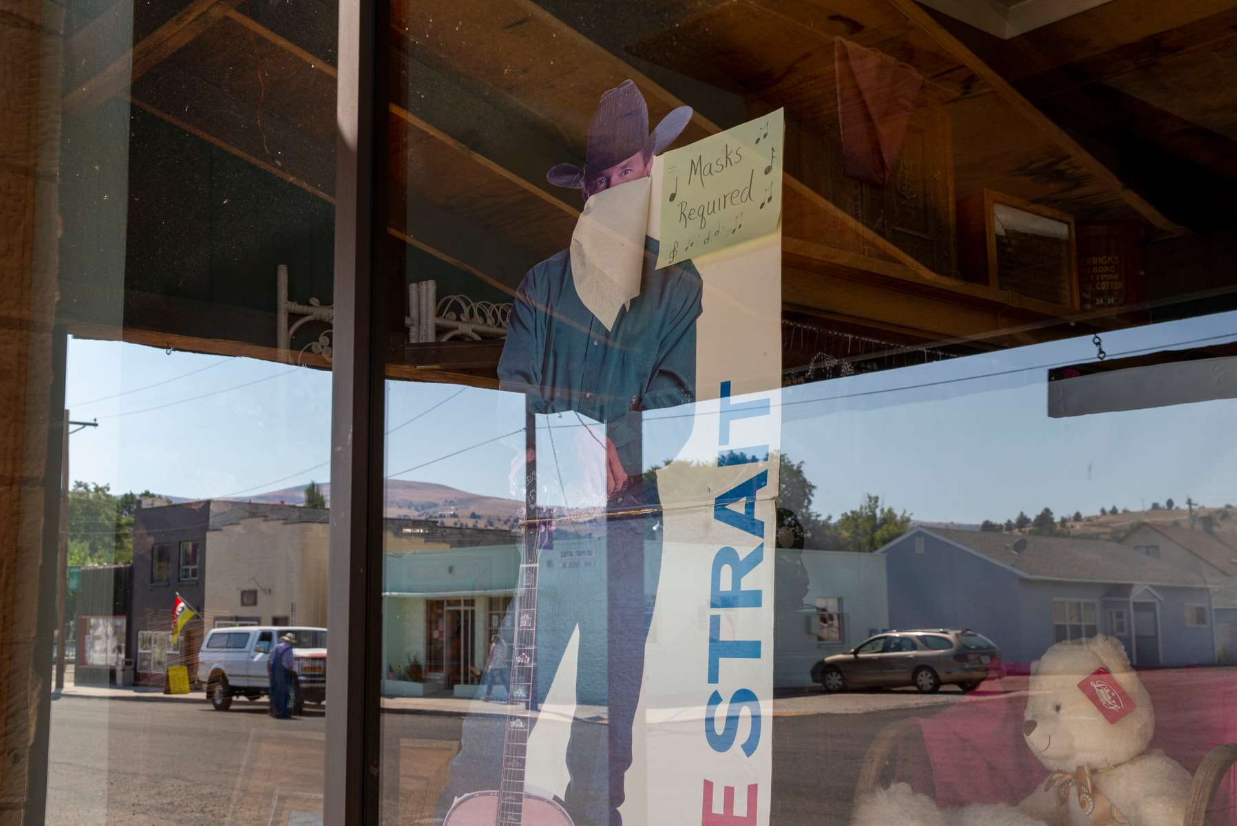 A George Strait cutout with a mask stands in the Fossil Mercantile reminding customers to wear a mask in Fossil Mercantile on September 4, 2020, in Fossil, Oregon.