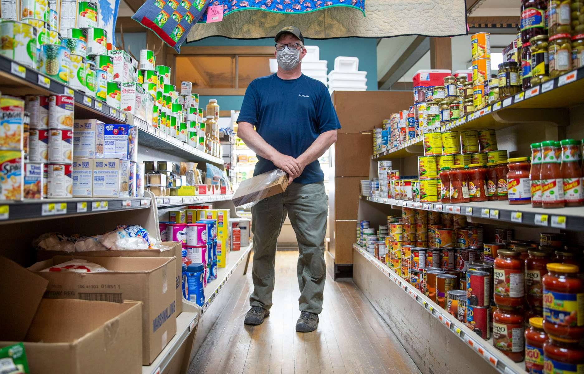 Fossil Mercantile owner Joe McNeil at his store on September 4, 2020, in Fossil, Oregon. McNeill was on the forefront of the mask-wearing policy in Wheeler County. He had his employees wearing masks before it was mandated and also had a implemented a required mask policy for customers.