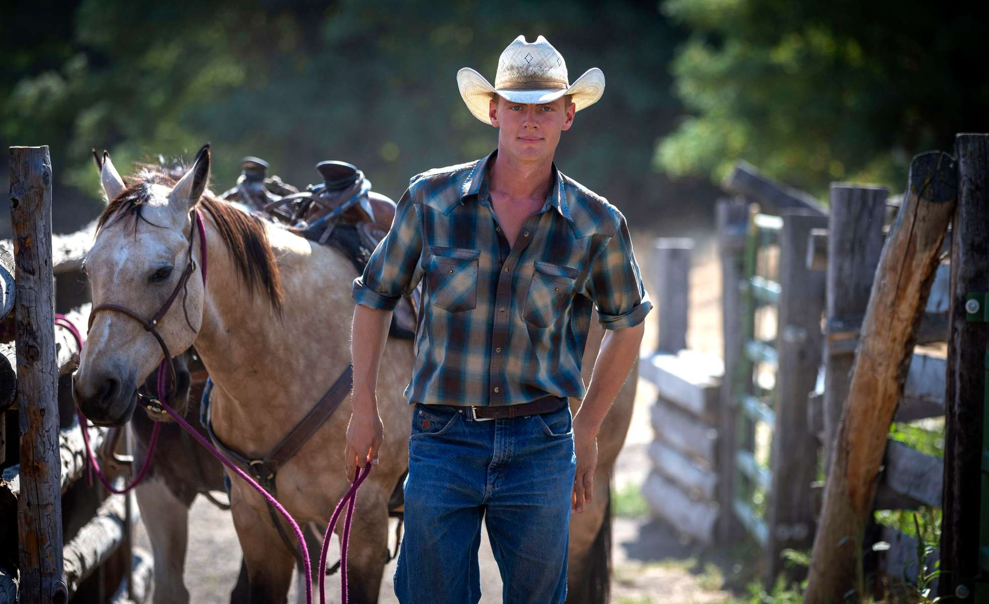 """Dima Anglin, a seventh generation cattle rancher at Wilson Ranches in Wheeler County and a senior at Oregon State University, leads a horse back to a barn on Sept. 4, 2020, in Fossil, Oregon. """"I saw this deal on Facebook that was saying people in Eastern Oregon have been social distancing since long before it was cool."""""""