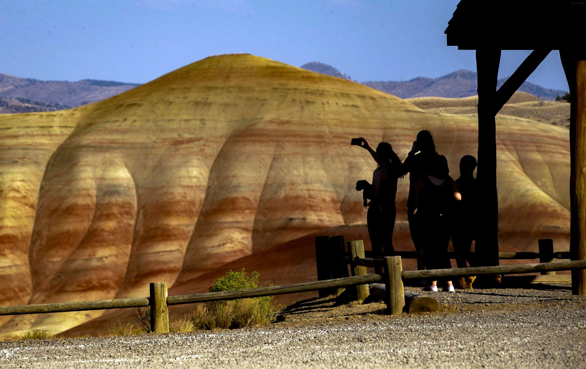 Tourists visit the Painted Hills in the John Day Fossi Beds National Monument Sept. 4, 2020, near Mitchell, Oregon. The monument attracts about 200,000 visitors a year with the Painted Hills being a top attraction after being named one of Travel Oregon's Seven Wonders of the state.