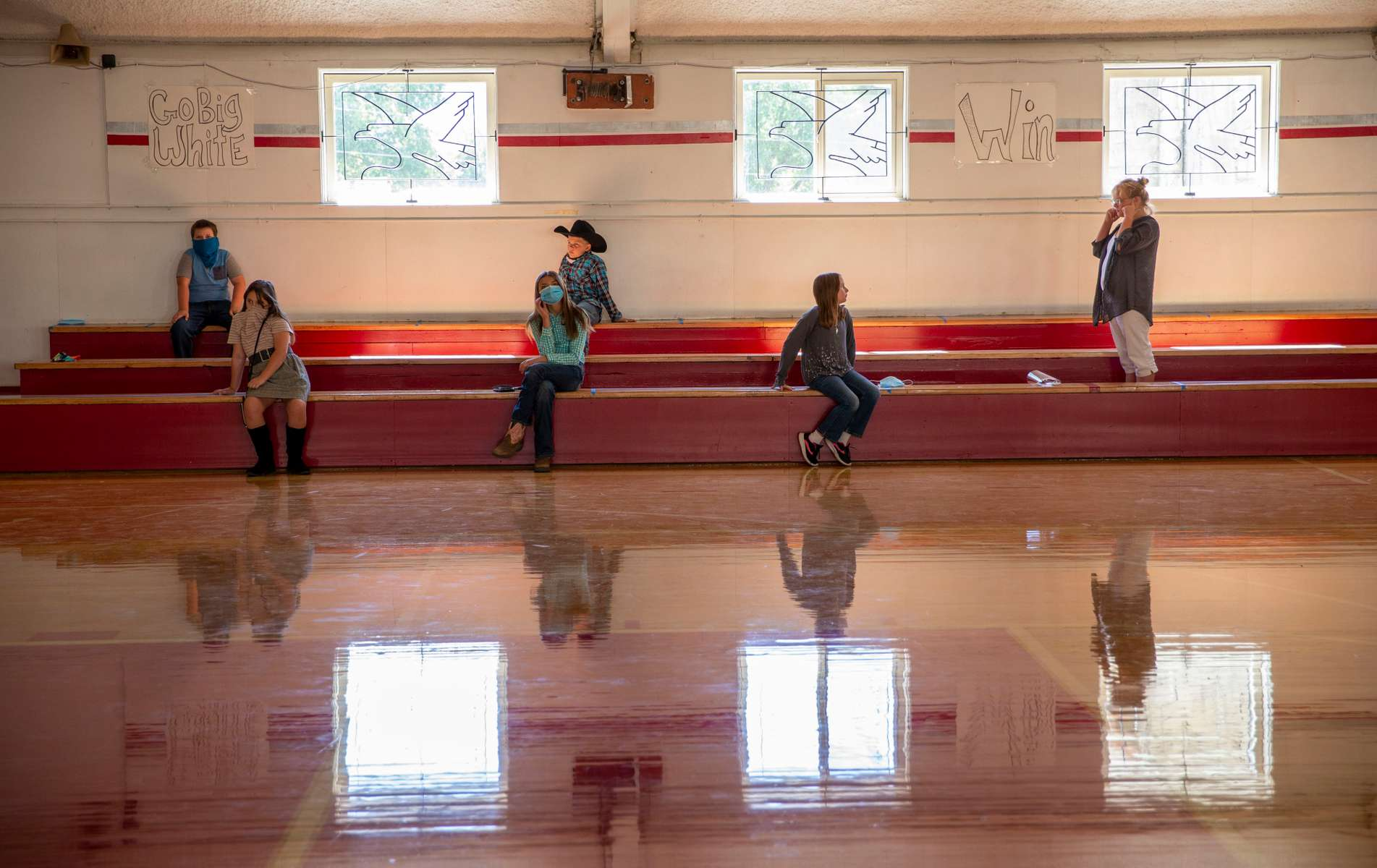 Students in the combined 4th, 5th, and 6th grade classes at Spray School wait for their turn to take school pictures on Sept. 2, 2020, in Spray, Oregon. The 48 students in grades K-12 are attending in-person classes at the school as are kids in the other two districts in  in Wheeler County.
