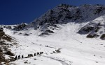Mule and men ascend the steep and snowy slopes from Khenj, Afghanistan to the emerald mines where miners work year round. Geologists believe emeralds are found in Afghanistan only in the Panjshir Valley.