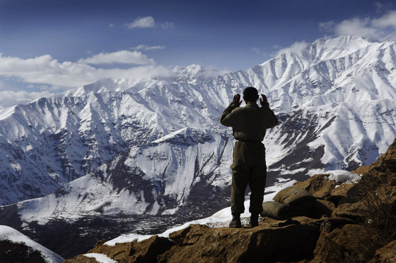 Amirdien prays at the encampment where he lives with his emerald mining partners high above the village of Khenj, Afghanistan. The mines are high in the Hindu Kush mountains making accessability difficult. The ruggedness also makes it easy to control who comes in and foreigners are viewed with suspicion.