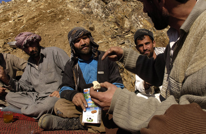 Mohammad Khodir and his friends enjoy tea before lunch at the encampment where he lives with his mining partners high above the village of Khenj, Afghanistan. Other than finding a big emerald, it are times with friends high in the mountains that he enjoys the most about working in the mines.