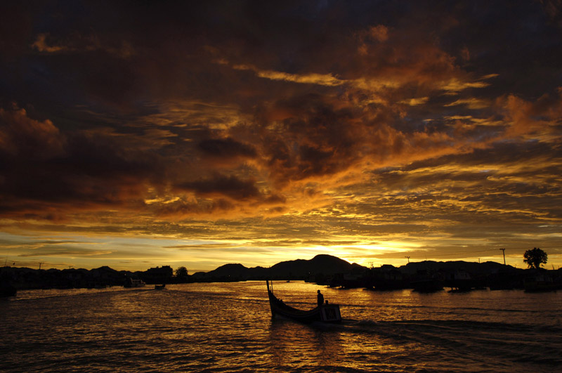 A fisherman returns up the Krueng River in Banda Aceh, Indonesia at the end of the day. The fishing industy has recovered after the losses from the Indian Ocean tsunami in 2004.