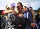 Ashton Eaton is embraced by his mother, Rosyln, right, and fiancee and UO heptathlete, Brianne Theisen, after he finished the decathlon's 1,500 meters at the U.S. Olympic Track and Field Trials. Eaton became the world record holder in the decathlon with 9,039 points.
