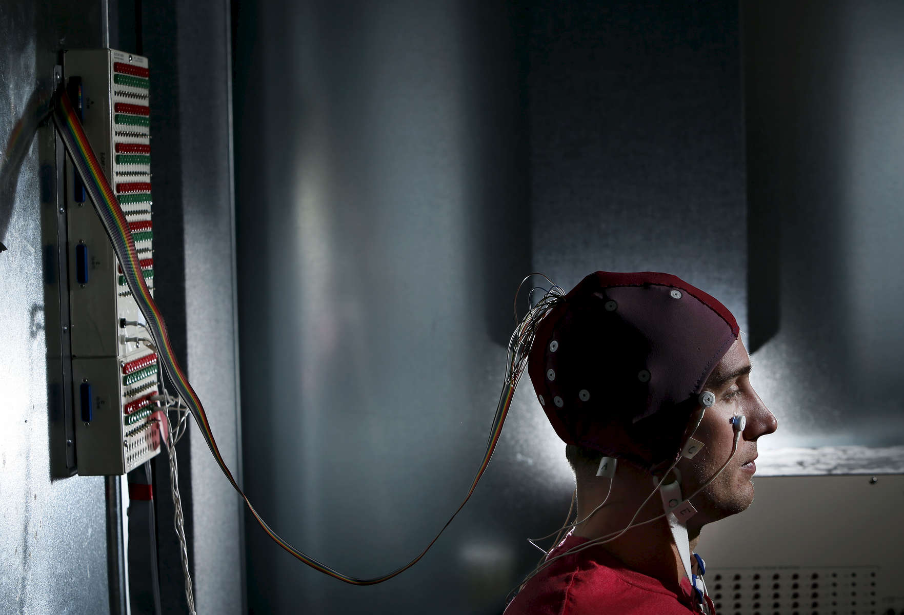 University of Oregon Psychology graduate student David Sutterer demonstrates the use of an EEG or electroencephalogram cap used to observe brain activity. Researchers in the Neurons to Minds cluster proposal would use EEG as one of the tools in their work to understand how the brain enables thought. Photographed at the University in Eugene on Monday, September 15, 2014. (Andy Nelson/The Register-Guard)