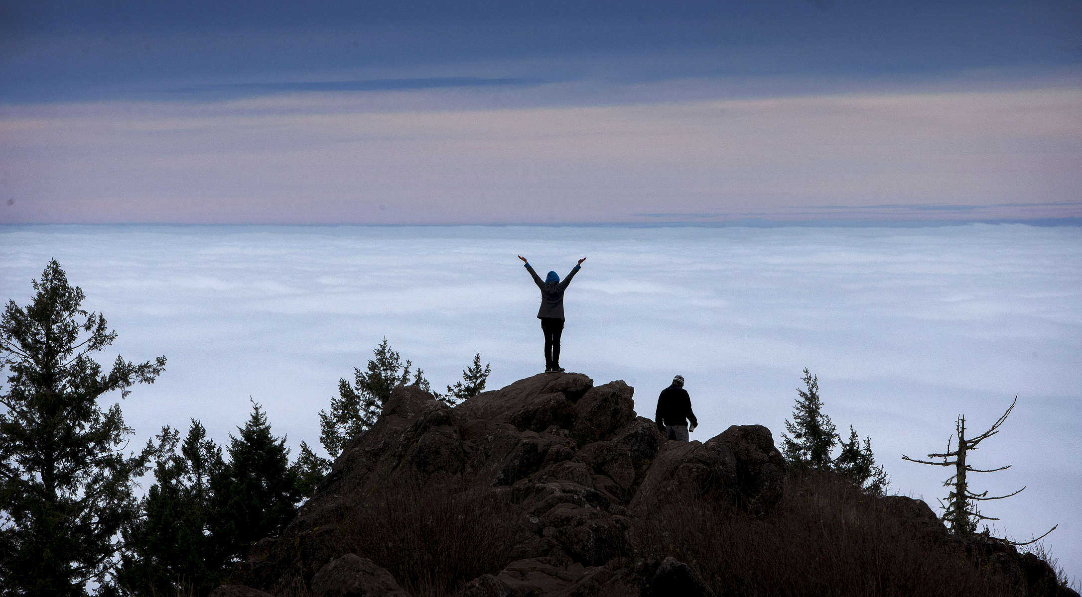 It might have been foggy in the Willamette Valley, but Cerridwen Martin was able to revel in a view of the top of the clouds from the 2,055 above sea level summit of Spencer Butte in Eugene, Ore., on Tuesday, December 16, 2014. Martin was joined by Joe Martinson, right, for the 1.1 mile trek. (Andy Nelson/The Register-Guard)