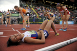 Great Britain's Morgan Lake collapses at the finish line after running the 800 meters in 2:21.39 to complete the heptathlon and claim the gold medal at the IAAF World Junior Championships at Hayward Field in Eugene on Wednesday, July 23, 2014. (Andy Nelson/The Register-Guard)
