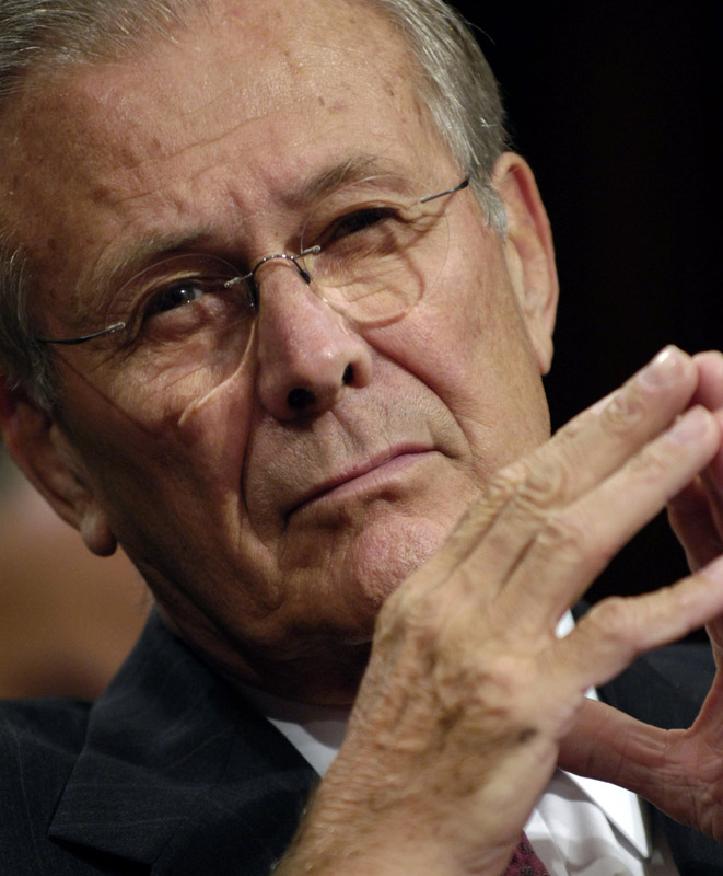 Secretary of Defense Donald Rumsfeld listens to a senator's question during a hearing before the Senate Armed Services Committee on thethe state of the wars in Iraq and Afghanistan.