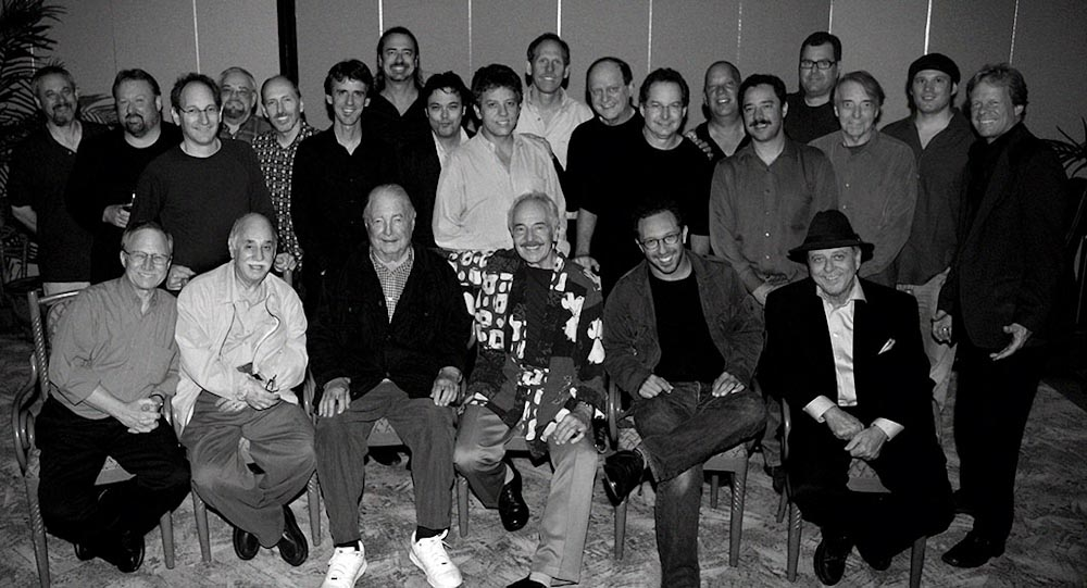Back row from left – 	Jon Kurnick, Doug MacDonald, Dan Sawyer, Ted Mayer, Brad Rabuchin, Steve Cotter, Mark Towns, Freddie Ramos, Frank Potenza, Bruce Forman, Del Casher, Pat Kelley Tim May Larry Koonse, Jim Fox, Mike Anthony, Jeff Rosenn, Jesse BradleyFront row from left – 	Barry Zweig, Ron Anthony, Bob Bain, John Pisano, Anthony Wilson, Ron Eschete