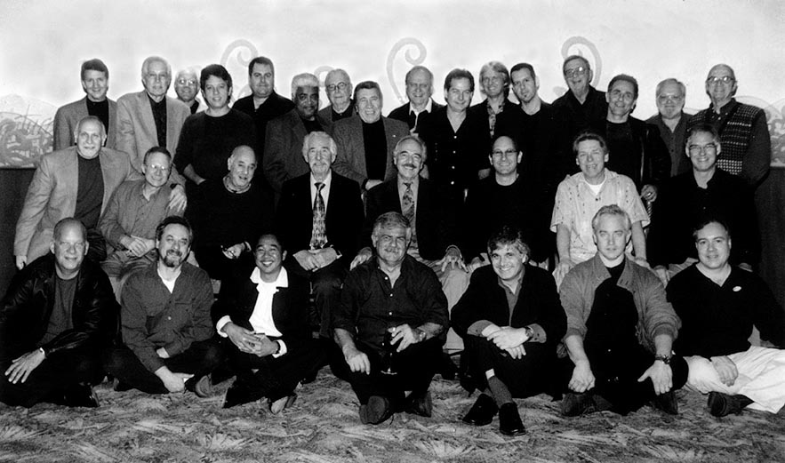 Back row from left- Randall Kremer, Kenny Burrell, Mitch Holder, Frank Potenza, Jim Fox, Phil Upchurch, Bob Bain, Charlie Cerrenza, Del Casher, Pat Kelley, Lawrence Robb, Tommy Kay, Chuck Niles, Tom Rotella, Ted Mayer, Jack, Tracy.Middle Row from left- Victor Lindenheim, Barry Zweig, Ron Anthony, Al Viola, John Pisano, Dan Sawyer, Jay Graydon, Luther Hughes. Front row from left- Tim May, John Kurnick, ?, Dori Caymmi, Laurence Juber, Sid Jacobs, Dick Weller.
