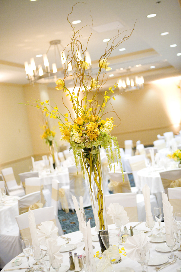 Tall wedding centerpiece yellow flowers centerpieces