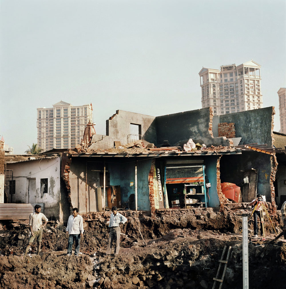 India, Mumbai, February 2008.In Mumbai slums are constantly being demolished to leave room for new hotels, luxury flats and offices of multi national companies to arise. Luxury is popping out as little diamonds spread across this immense city.