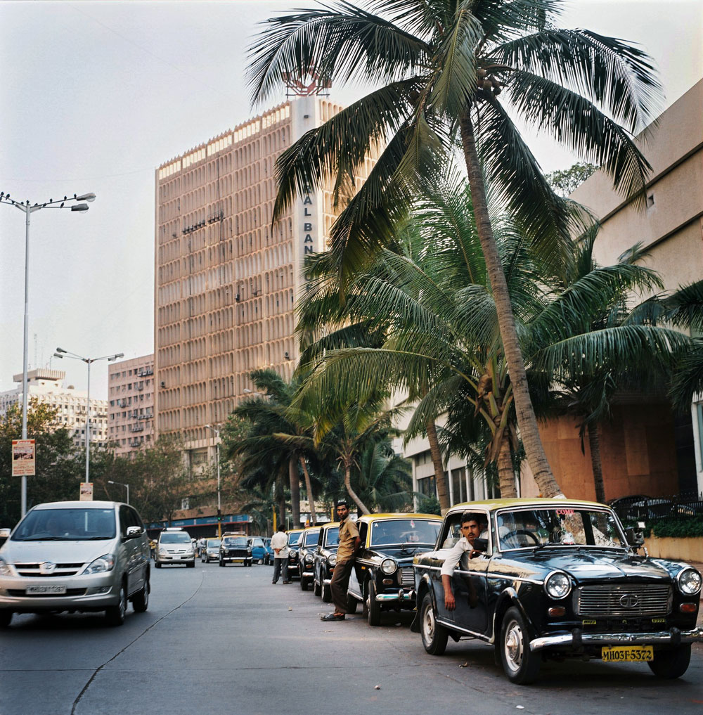 India, Mumbai, February 2008.Many taxi drivers, standing outside the National Bank in the city center of Mumbai, waiting to pick up customers from all the office buildings which are located there.