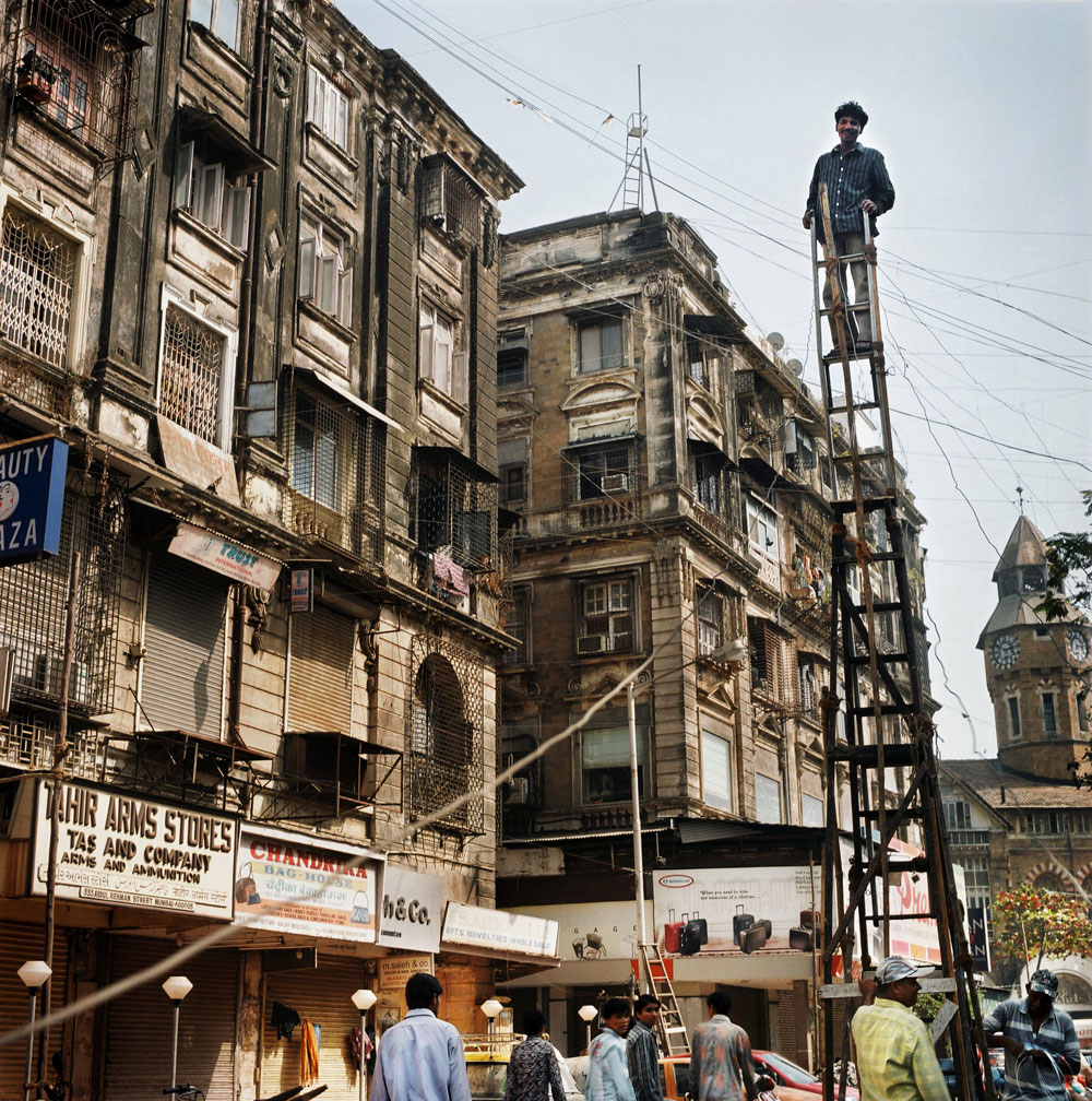 India, Mumbai, February 2008.Mumbai is still keeping it's contrasts. A young Indian boy fixing the electricity wires manually in a very new and developing city..Maharashtra may have cornered the bulk of foreign investment in the post-reform years, but that hasn,Äôt translated into more jobs. Even if Mumbai is the commercial centre it has still a very high percentage of unemployment.
