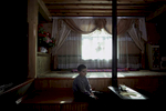 Roshkala, Tajikistan, October 2016After coming home from school a young boy sits in a quiet moment in his living room.