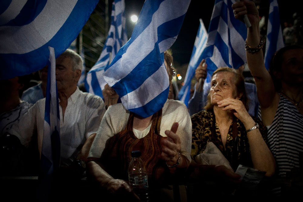 Athens Greece June 15, 2012Supporters waving flags at the pre-election speech of Antonis Samaras the leader of the New Democracy conservative party.