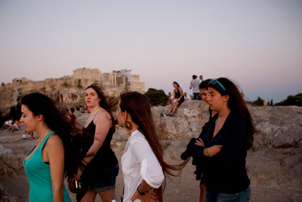 Athens Greece, June 17, 2012, Election dayA group of young girls walking on the rock of Areios Pagos next to the Acropolis. Visits to Greece's sun-drenched islands and ancient ruins account for about 15 percent of the economy and one in five jobs, making income from tourism crucial for a country grappling with a fifth year of recession.