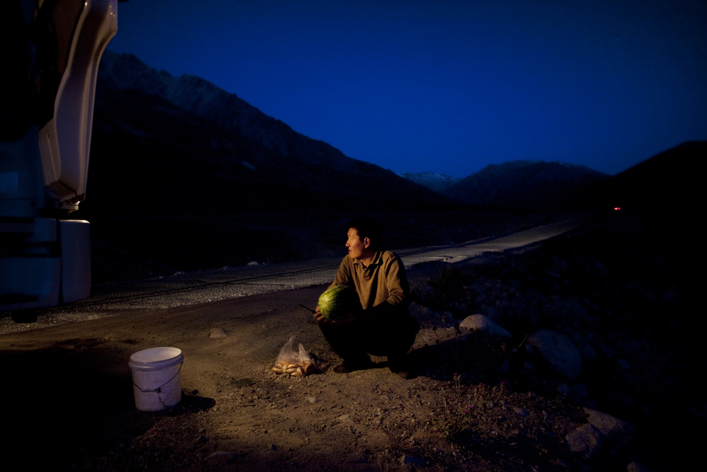 On the way to Murgab, Tajikistan 2011-A Chinese truck driver on a stopover towards Murgab, having his dinner.