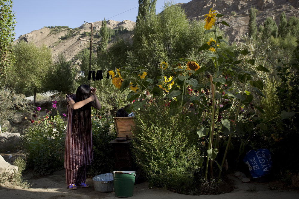 Roshkala region, Tajikistan 2011-A girl brushing her hair in the Tavdem subdistrict, close to Khorog.