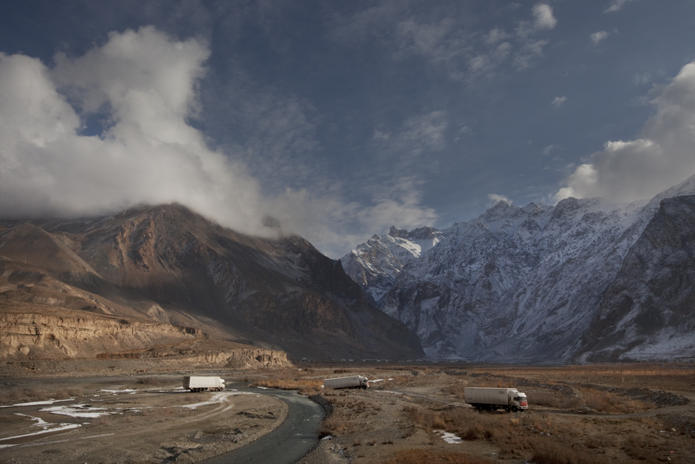 Pamir Mountains, Tajikistan 2014Chinese trucks passing through the mountains. They are trying to reach the borders with China to deliver the goods, before the road closes due to the weather conditions.