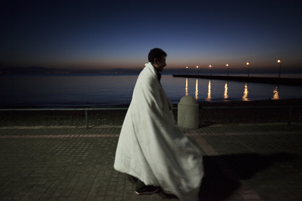 Greece, Kos island 2015An immigrant wondering about at dawn in front of the port in the island of Kos.