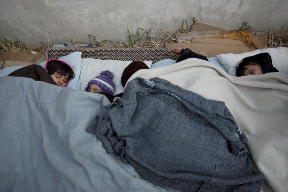 Greece, Kos island 2015Children sleeping after their arrival  from Bodrum,  Turkey, to the island of Kos.  The journey can cost them from 1000$ to 1500$ per head.