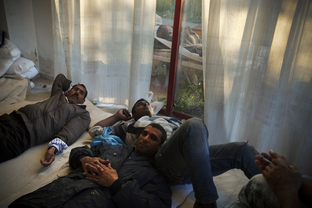 Greece, Kos island 2015A group of Pakistani immigrants relaxing inside the hotel of \{quote}Captain Elias\{quote}. They have been on the island for five days already and they still have ten more days before their trip to Athens. Their final goal is to reach Germany.