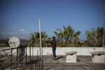 Greece, Kos island 2015Looking for a signal on the terrace of \{quote}Captain Elias\{quote} hotel. An abandoned hotel that has become a temporary camp for all the immigrants that arrive on the island of Kos.