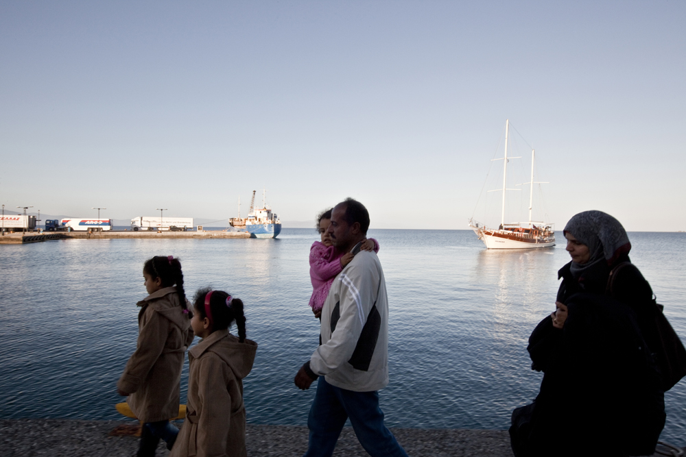 Greece, Kos island 2015A Syrian family leaving the island of kos for their next trip to Athens. Jumana 36 with her husband Ali 44, are the parents of Nour 14, Hussien 12, Marwa 10, Batoul 6 and Lamar 3 years of age. They flue to Tyrkey from Lebanon and from Tyrkey to Greece they where trafficked by boat.  Their trip as a family cost them 4700$ and they want to reach Germany as a final destination where they want to start their new life.