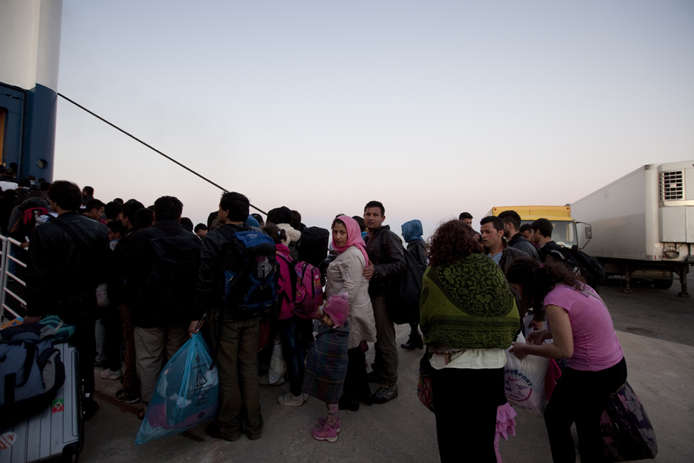 Greece, Kos island 2015Immigrants ready to board on the boat that will take them to Athens as their next destination before their final destinations around Europe. Once immigrants are in Greece, most of them are intercepted by the Coast Guard or Police border guards. The present law requires all of them to be identified, and then to be given a 30-day temporary permit before they are obliged to leave the country.