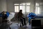 Greece, Polikastro 2015Abed Alrahman 25, waiting in the hospital room after an attack from the mafia inside Macedonia. He has been injured in the war in Syria  having full paralysis in both of his legs. His friends were carrying him throughout the hole journey in their arms and the ones who tried to protect him were severely injured.