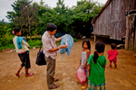 VMW's (Village Malaria Workers) carry out IEC and BCC Malaria prevention activities with villagers in Phnom Dambang Village in Cambodia on September 20, 2011.