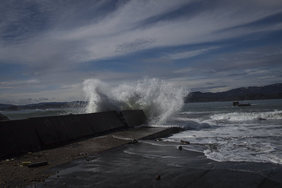 A wave crashes on a beach near Nakayama, Japan where several oyster and fish processing factories were located before the 2011 tsunami ravaged the area.