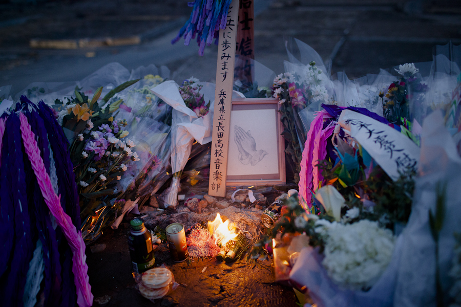 Flowers, candles and paper cranes memorialize local victims in Natori, Japan on the one year anniversary of an earthquake and tsunami that left more than 19,000 people dead or missing on March 11, 2011.
