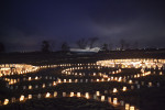 Paper lanterns illuminate a boat carried far onto shore during an earthquake and tsunami that left more than 19,000 people dead or missing on March 11, 2011. Image taken on the one year anniversary in Natori, Japan.