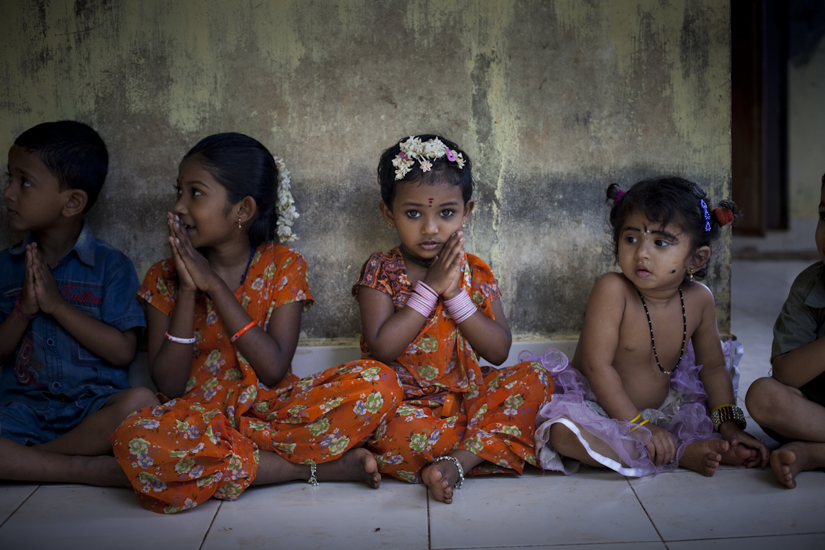 Children sit at a preschool in Kerala, India. Kerala has the lowest maternal and infant mortality in the country, comparable to many wealthy countries. In an effort to maintain their reputation as a place that outperforms in health, despite its poor economic state, the government is attempting to address chronic diseases, currently one of the most pressing concerns in the state.