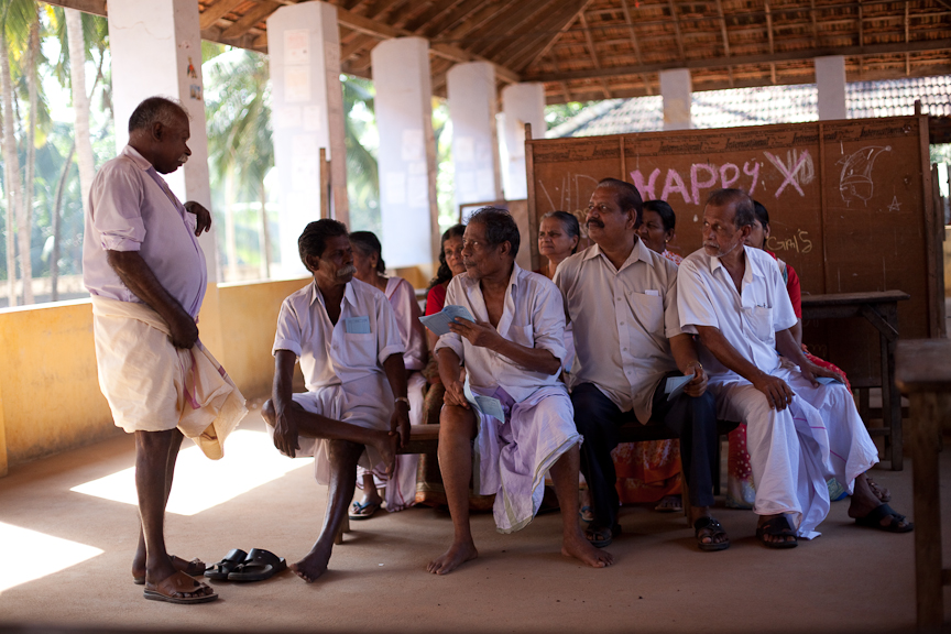 A group of residents wait to participate in a free check up for glucose and blood pressure. A pilot study is testing whether chronic disease prevention can successfully be added to kerala's renowned primary health care system.