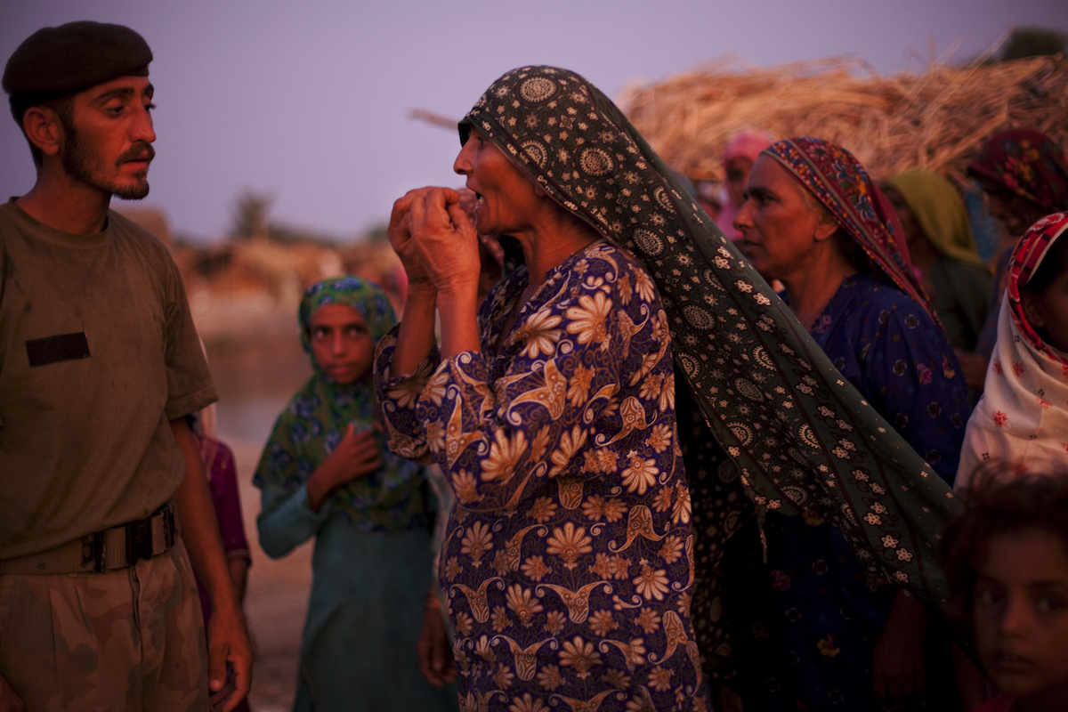 A woman begs a member of the Pakistan army for food on the eve of Eid ul Fitr, the most celebrated day of the year for Muslims.