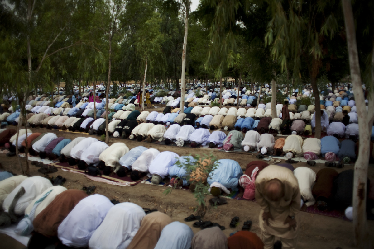Male residents and IDPs from the floods pray in a field in Dadu for Eid al-Fitr, the end of the Muslim holy month of Ramadan, on September 11th, 2010. Women are generally prohibited from entering prayer areas.