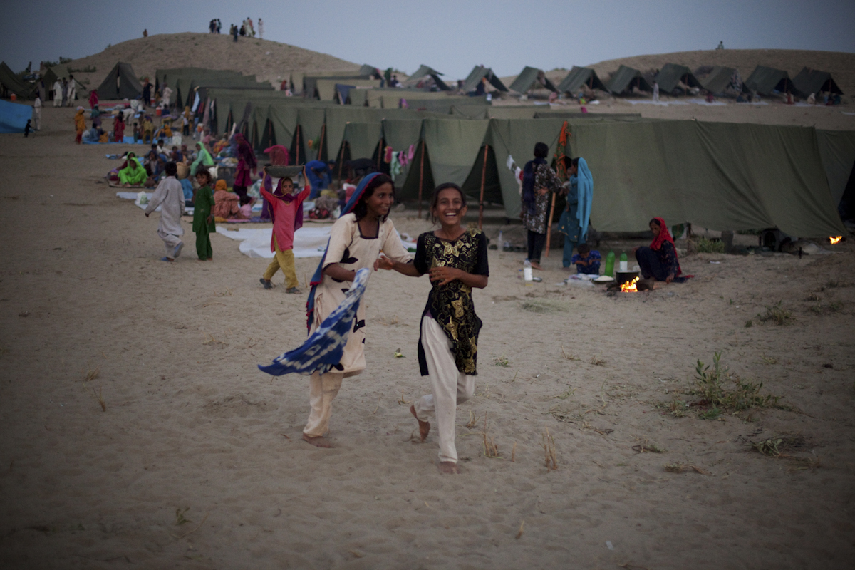 Two young girls play in a Pakistan Army run IDP camp near Sehwan Sharif, Sindh province.