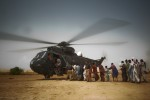 Flood victims line up to be evacuated by a Pakistani Navy helicopter in Faridabad, Sindh province on September 13, 2010.