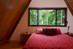 Guest bedroom in treehouse at Rose Gums Wilderness Retreat