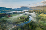 Aerial view of morning mist over cane farms in the Goldsborough Valley, Cairns