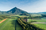 Aerial view of sugar cane farmlands and Walsh's Pyramid, Cairns