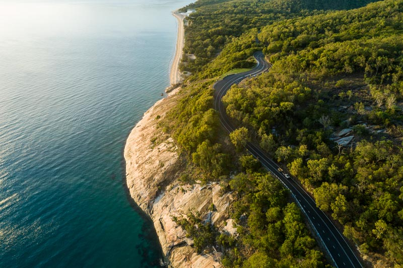 Aerail view of car driving along coastal highway at Rex's Lookout between Cairns and Port Douglas