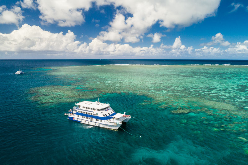 Aerial view of OceanQuest dive vessel moored in Great Barrier Reef Marine Park, Cairns